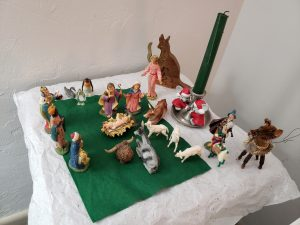 Parish Administrator Susan Robinson's set always as a menagerie. Latest is a llama from a friend's 2019 trip to Peru